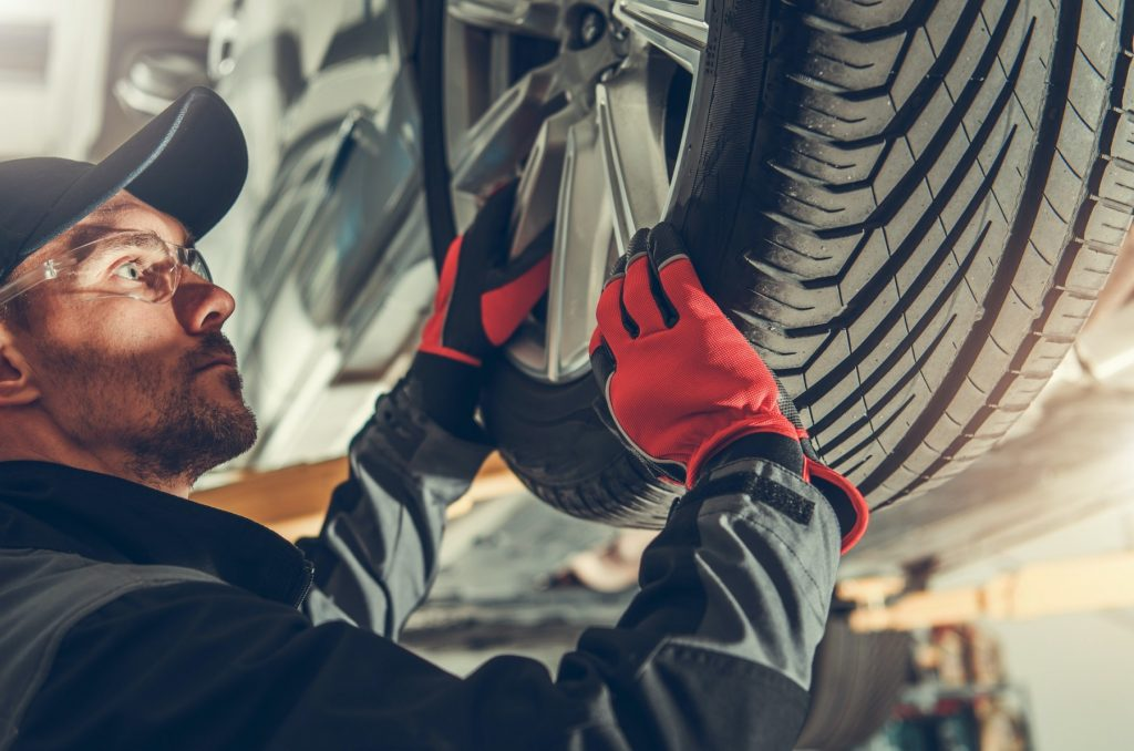 Auto Service Worker Replacing Car Tires